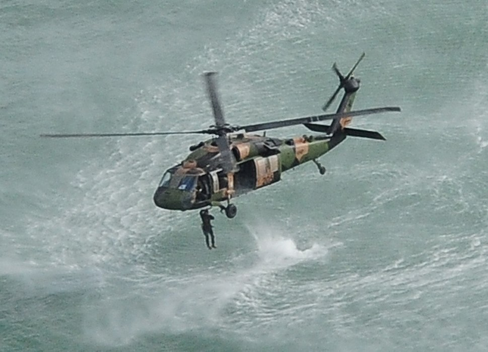 1st Commando Regiment soldier jumping out of an Australian Army blackhawk helicopter in 2013