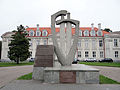 220913 Monument in the courtyard of the Bishop Palace in Wolbórz - 01.jpg