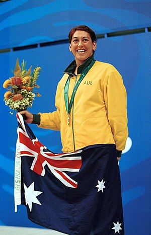 Priya Cooper - Cooper shown smiling on the gold medal podium for her win in the 400 m freestyle S8 at the 2000 Summer Paralympics