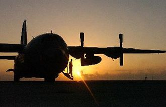 321st Air Expeditionary Wing - A 321st Expeditionary Maintenance Squadron crew chief, emerges from a C-130 Hercules after conducting a pre-flight inspection.