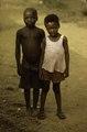 ASC Leiden - F. van der Kraaij Collection - 01 - 022 - Two boys outdoors posing for the cameraman - Monrovia, Old Road, Montserrado County, Liberia, 1976.tiff