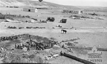 Water basin under construction, with horse tethered in center