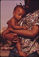 A SOUTH SIDE CHICAGO GHETTO MOTHER AND CHILD WHO LIVE IN NEARBY LOW INCOME HOUSING. THEY ARE PART OF THE 1.2 MILLION... - NARA - 556144.jpg