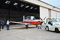 A T-6B Texan II aircraft is maneuvered into place at Naval Air Station Whiting Field, Fla., Aug. 27, 2012 120827-N-WW980-004.jpg