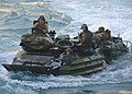 A U.S. Marine Corps assault amphibious vehicle assigned to the 26th Marine Expeditionary Unit approaches the well deck of the amphibious dock landing ship USS Carter Hall (LSD 50), not pictured, in the Atlantic 130313-N-XZ031-443.jpg