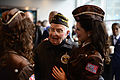 A World War II veteran speaks with Victory Belles at the grand opening of the U.S. Freedom Pavillion- The Boeing Center in New Orleans, La., Jan. 12, 2013 130112-G-BA041-001.jpg