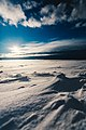 A blue sky above white snow (Unsplash).jpg