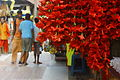 A bunch of Hibiscus flowers in a shop, Kamakhya Temple.JPG