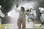 A member of the Marine Corps Air Station Beaufort fire department is washed as he goes through a decontamination center at the sight chemical spill at the training pool at Marine Corps Air Station Beaufort 130719-M-VR358-093.jpg
