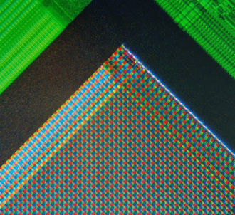 Image sensor - A micrograph of the corner of the photosensor array of a webcam digital camera