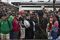A soldier with the Armed Forces of the Philippines, right foreground, gives instructions to a crowd at Tacloban Air Base, Philippines, Nov. 14, 2013, during Operation Damayan 131114-M-FF989-901.jpg