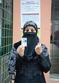 A young lady in traditional attire displaying identity card after cast her vote in front of a polling booth, during the third phase of West Bengal Assembly Election, in Chowringhee constituency of Kolkata North.jpg