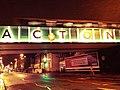 Acton High Street Railway Bridge With Illuminated Sign.jpg