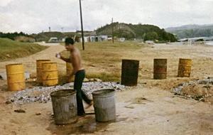 Camp Schwab - 1971: Marine Scott Parton at Camp Schwab on Okinawa near Agent Orange Barrel (second from right)