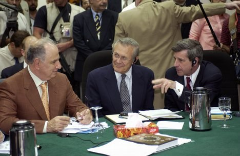 Ahmed Chalabi in discussion with Paul Bremer and Donald Rumsfeld