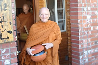 Ajahn Pasanno - Ajahn Pasanno walking in Ukiah, accepting offerings of alms food. Full Moon Observance Day, September 2013 (Photo by Brian Carniello)