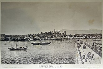 Seedamm - 1878 photograph by Alwina Gossauer showing the railway causeway, a panoramic view of Rapperswil and of the Bachtel mountain.