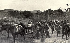 "Battle of Las Guasimas - ""On the battleground of Las Guasimas - Americans going to the front"" in Harper's Pictorial History of the War with Spain, Vol. II, 1899."