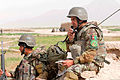 An Afghan National Army radio operator with the 6th Kandak, 1st Brigade, 205th Corps communicates with his team during a joint combined patrol with Afghan National Police officers in Panjwai district in southern 120401-N-BS894-103.jpg