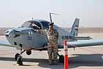 An Iraqi air force pilot with a CH2000 reconnaissance plane.jpg