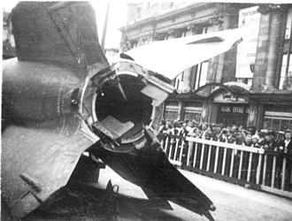 V-2 rocket - Captured V-2 on public display in Antwerp, 1945. Exhaust vanes and external rudders in tail section shown.