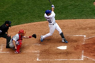 Aramis Ramírez - Ramirez hitting one of his three home runs during a game at Wrigley Field against the Philadelphia Phillies on July 30, 2004