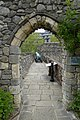 Archway from St Denys Priory in the Garden of Tudor House, Southampton.jpg