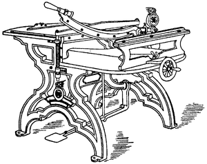 Line draing of a table-like macine, including guillotine blades and hand-wheels.