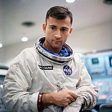 Photograph of Young standing in his Gemini spacesuit