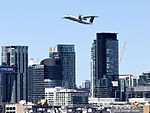 August 2012 Porter Q400 Airplane Over Toronto Waterfront Skyline (7737545654).jpg