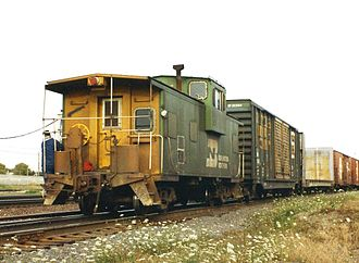 Caboose - A Burlington Northern Railroad extended-vision caboose at the end of a train in 1993