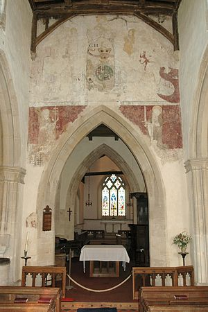 Beckley, Oxfordshire - Parish church of the Assumption: chancel arch with 14th-century paintings of Doom and SS Peter and Paul, plus 18th-century painting of Royal arms.