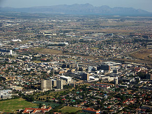 Bellville CBD with Kogelberg Mountains and False Bay in distance