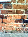 Benchmark on ^46 Mill Street - geograph.org.uk - 2335212.jpg