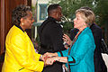 Bobbie Williams, left, the wife of U.S. Marine Corps Lt. Gen. Willie J. Williams, center, exchanges greetings with Margaret Gibson, the wife of Sloan Gibson, the president of the USO and Evening Parade guest 130524-M-MM982-001.jpg