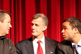Boom Chicago - Greg Shapiro (center) and Michael Orton-Toliver (right) as Amsterdam cops interviewing an audience member in 2006