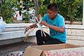 Boy preparing to sell their sacred palms.jpg