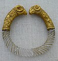 Bracelet of rock crystal with gold rams heads Greek part of the Ganymede Jewelry collection 330-300 BCE (1485559017).jpg