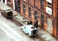British troops investigate a couple on the street in Belfast.jpg