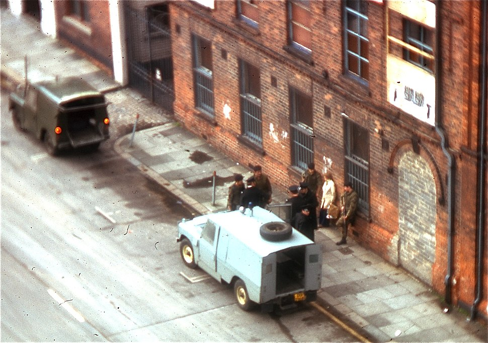 British troops investigate a couple on the street in Belfast