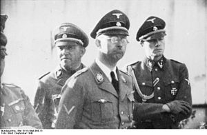Joachim Peiper - Sepp Dietrich (left, behind Himmler), Heinrich Himmler (centre) and Joachim Peiper (right) at Metz in September 1940.