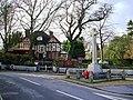 Burley War Memorial with the Burley Inn behind - geograph.org.uk - 654108.jpg