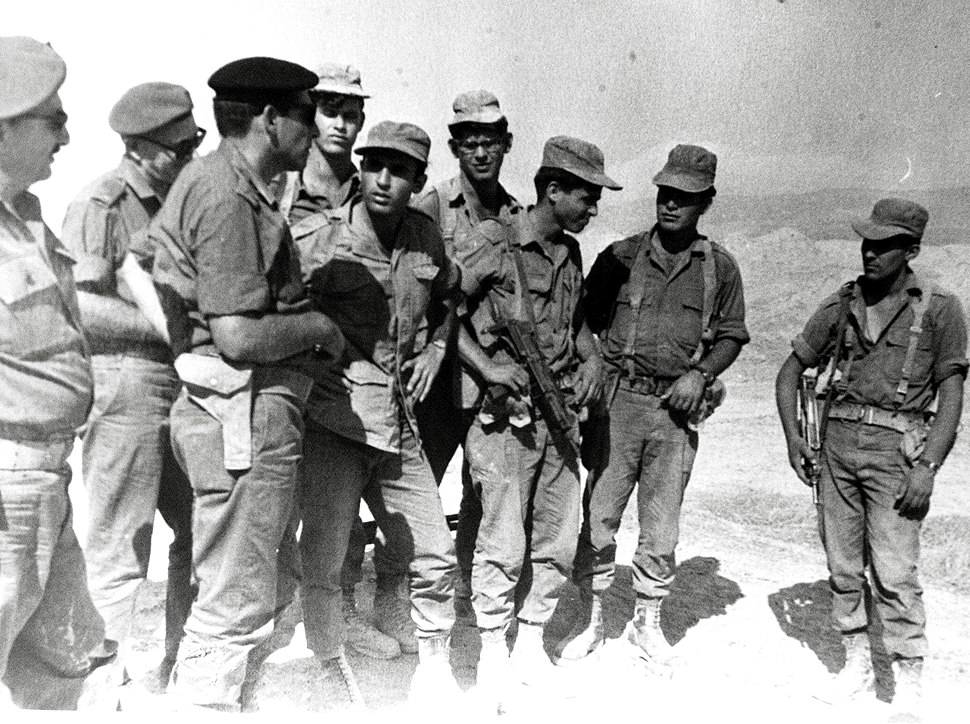 C.O. OF CENTRAL COMMAND RECHAVAM ZEEVI AND SERGEANT SHAUL MOFAZ (AT HIS RIGHT), AFTER A PURSUIT IN THE JORDAN RIFT
