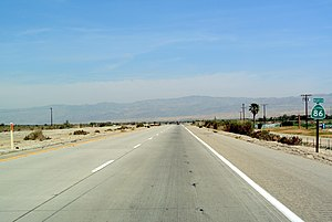 California State Route 86 - SR 86 north of Salton City, looking north. Salton Sea in the background.