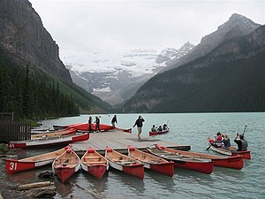 Canoe livery - Rental canoes at Lake Louise, Banff National Park, Alberta, Canada. Note the numbers for tracking