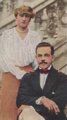 Card No. 157, Ex-King Manuel of Portugal and his German Wife who is Related to Kaiser Wilhelm, from the World War I Scenes series (T121) issued by Sweet Caporal Cigarettes.png