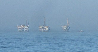 Carpinteria Offshore Oil Field - The three platforms of the Carpinteria field, as seen from the shore north of La Conchita.  From left to right they are Platforms Hogan, Houchin, and Henry.