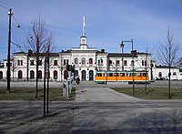 The central railway station and one of the famous orange trams