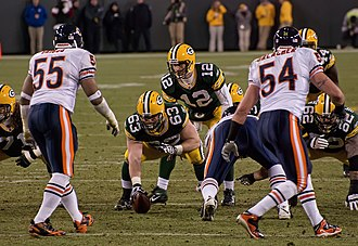Linebacker - In white jerseys, Lance Briggs (55) and Brian Urlacher (54) of the Chicago Bears, are positioned as linebackers on Lambeau Field in 2011