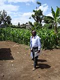 Church bishop and teacher in front of maize field in the school compound (5792212021).jpg